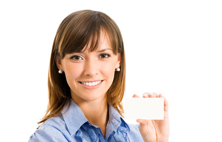 give out: Happy smiling businesswoman with blank business card, isolated on white backround. Success in business concept studio shot. Stock Photo