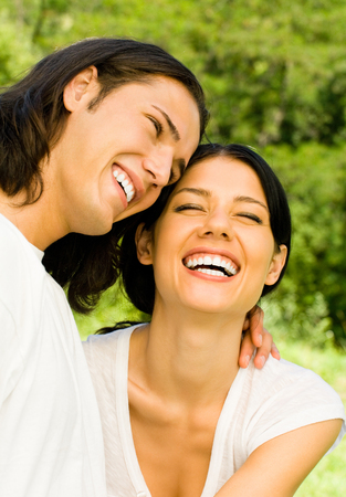 Happy smiling young couple on romantic date outdoors. Love, flirt, romantic, relations theme concept.