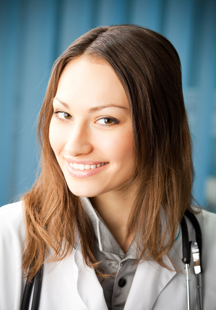 health care and medicine: Portrai of happy smiling young female doctor at office. Medicine and health care concept.