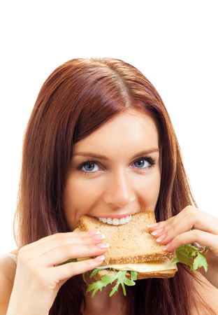 Hungry gluttonous woman eating sandwich with cheese, isolated on white background Stock Photo
