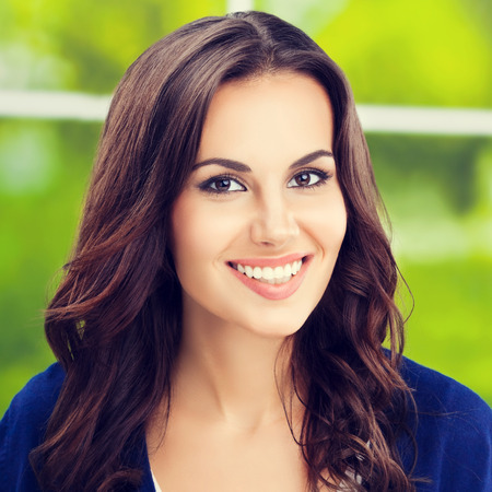 Portrait of happy smiling young brunette woman