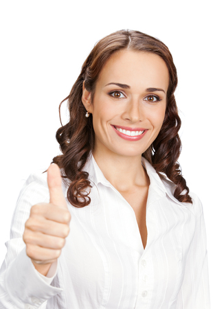 Happy smiling businesswoman with thumbs up gesture, isolated on white background. Caucasian female model in business success concept studio shot. Stock Photo
