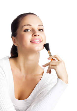 Young happy smiling woman with cosmetics brush, isolated on white background