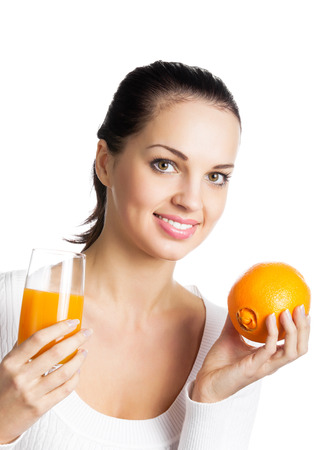 Portrait of happy smiling young woman with orange and glass of orange juice, isolated on white background