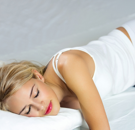 Portrait of young sleeping woman at bedroom Stock Photo