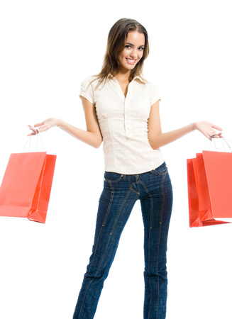 Full body portrait of young happy woman with shopping bags, isolated on white background Stock Photo