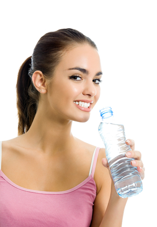 Young happy smiling woman in sportswear with water, isolated on white background