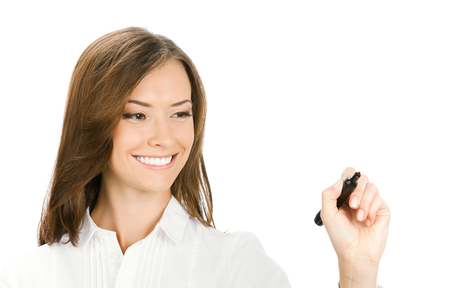 glassboard: Happy smiling cheerful young businesswoman writing or drawing on screen with blue marker, isolated on white background. Business success concept.