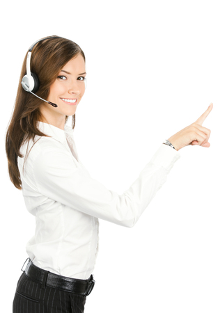 glassboard: Call center. Portrait of happy smiling customer support service phone operator in headset pointing at something, isolated against white background. Stock Photo