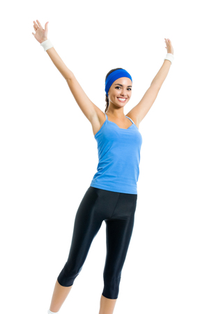afroamerican: Full body of young happy smiling woman doing fitness exercise, isolated on white background. Sport and healthy lifestyle concept.