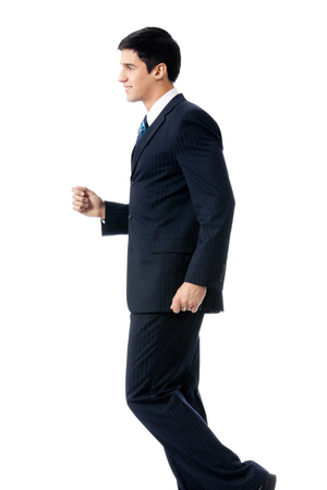 Full body portrait of walking young businessman, isolated over white background. Success in business and education concept.