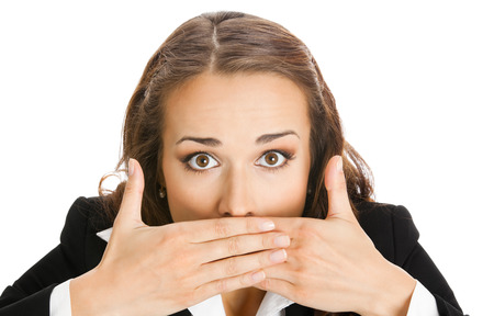 Portrait of surprised excited young businesswoman covering with hands her mouth, isolated on white background. Success in business concept.