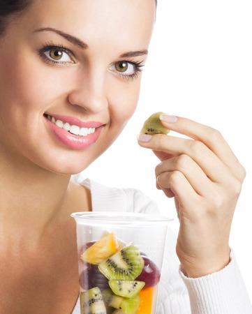 niña comiendo: Mujer con una variedad de cítricos, aislado sobre fondo blanco Foto de archivo