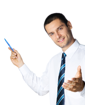Happy smiling young businessman showing blank area for sign or copyspase, isolated on white background. Success in business, job and education concept shot.