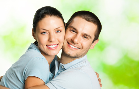 Portrait of young happy smiling attractive couple, outdoors. Love, dating and relationships concept. photo
