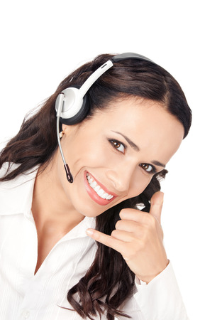 handsfree telephone: Portrait of happy smiling customer support phone operator in headset with call me gesture, isolated on white background. Consulting and assistance service call center.