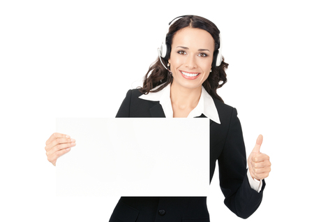 Happy smiling young customer support phone operator in headset showing blank signboard with thumbs up, isolated on white background. Consulting and assistance service call center. photo