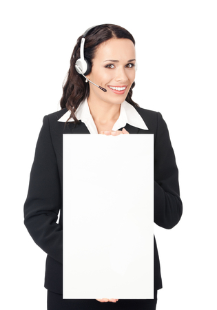 Happy smiling young customer support phone operator in headset showing blank signboard, isolated on white background. Consulting and assistance service call center. photo