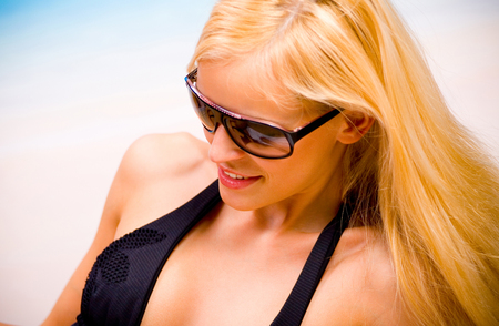 portait: Portait of happy smiling cheerful young beautiful blond woman on the beach Stock Photo