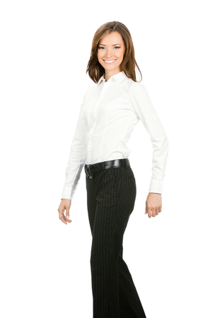 Full body portrait of walking businesswoman, isolated on white background. Success in business concept studio shoot. photo