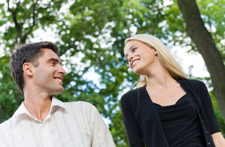 flirtation: Portrait of young happy smiling cheerful walking attractive couple together, outdoor. Love and relationships concept.