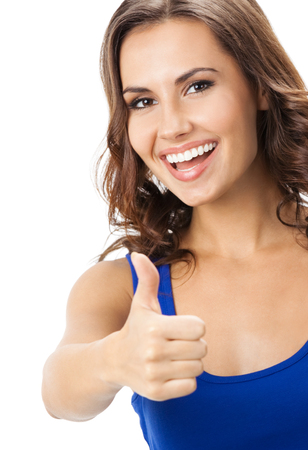 Happy smiling beautiful young woman showing thumbs up gesture, isolated over white background. Emotional concept studio shot. photo