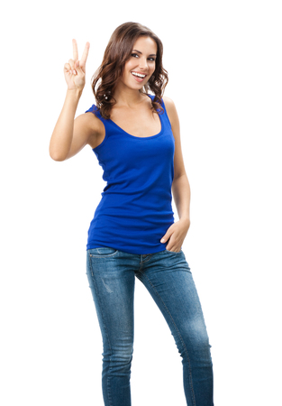 Full body portrait of happy smiling beautiful young woman showing two fingers or victory gesture, isolated over white background. Emotional concept studio shot. photo