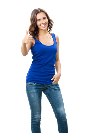 Full body portrait of happy smiling beautiful young woman showing thumbs up gesture, isolated over white background. Emotional concept studio shot. photo