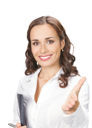give out: Happy smiling businesswoman giving hand for handshake, isolated on white background. Success in business concept. Stock Photo