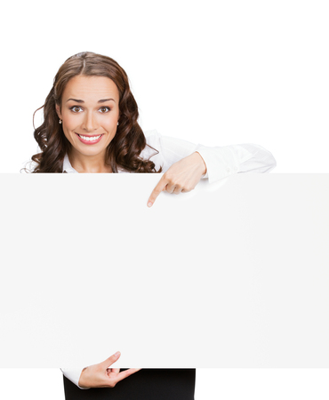Happy young businesswoman showing signboard, with blank copyspace area for slogan, advertisiment or text message, isolated against white background. Success in business concept studio shot. photo