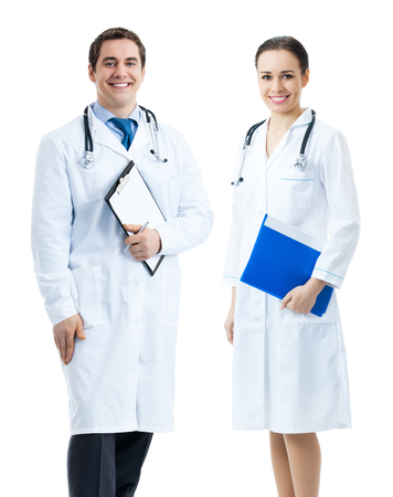 Full body portrait of young happy smiling doctor with clipboard, isolated over white background. Medicare, health care and medical occupation concept shot. photo