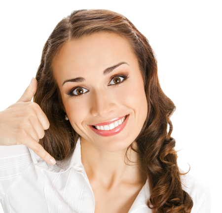Young happy smiling business woman with call me gesture, isolated over white background Stock Photo