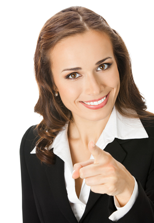 Portrait of young happy smiling businesswoman pointing finger at you, isolated over white background. Success in business concept. photo