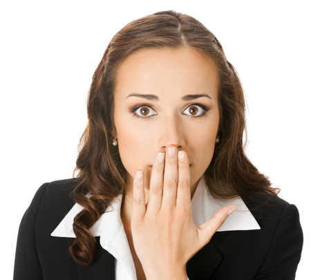 Portrait of surprised excited young businesswoman covering with hand her mouth, isolated on white background. Success in business concept. photo