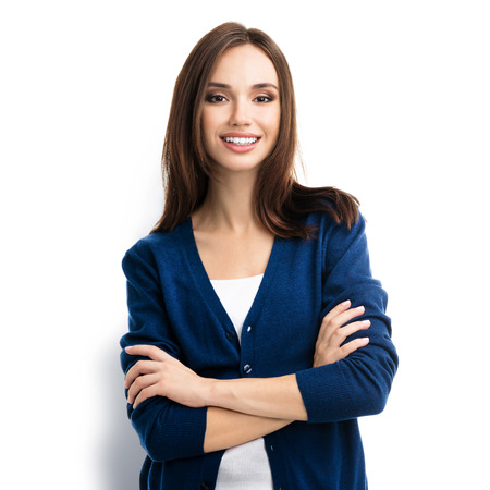 Portrait of young smiling woman in casual smart blue clothing with crossed arms, isolated against white background