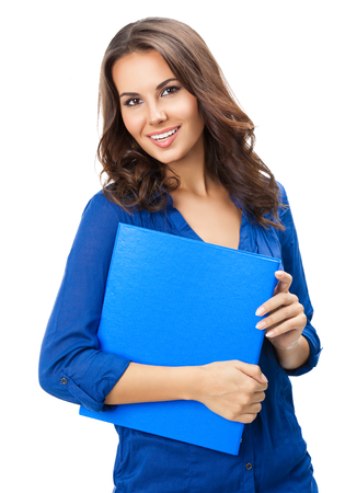 Portrait of happy smiling young cheerful businesswoman with blue folder, isolated over white background. Caucasian brunette model in business concept studio shoot. photo