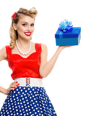 Portrait of smiling woman dressed in pin-up style dress with polka dot, isolated over white background. Caucasian blond model posing in retro fashion and vintage concept studio shoot.