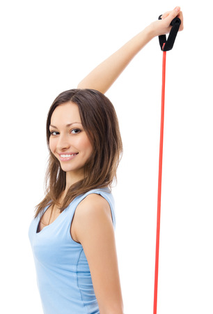 cutouts: Young happy smiling woman dowing fitness exercise with expander, isolated over white background. Individual exercising, fitness, workout and healthy lifestyle concept. Stock Photo