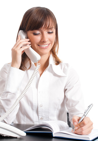 call out: Happy smiling successful business woman with phone, isolated over white background