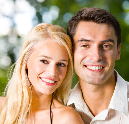 Portrait of young happy smiling cheerful attractive couple together, outdoors. Love, relationships and dating concept. Stock Photo