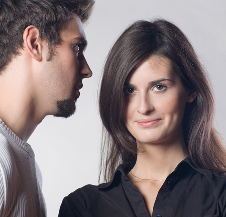 rumour: Portrait of young attractive happy amorous couple. Love, relationships and dating concept. Stock Photo