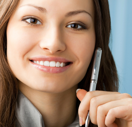 Young happy smiling cheerful businesswoman at office. Success in business and people at work concept. photo