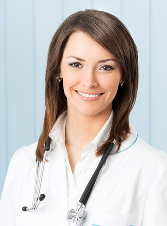 Portrait of happy smiling doctor at office. Healthcare, lab and medical concept. photo