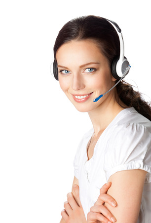 handsfree telephone: Portrait of happy smiling cheerful beautiful young support phone operator in headset, isolated over white background. Caucasian brunette model in help service and client consulting call center concept.