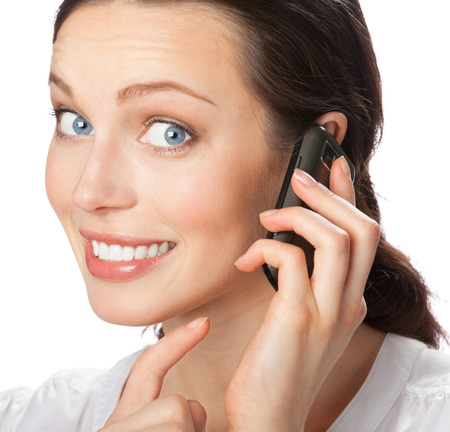 Young happy smiling businesswoman with cell phone, isolated over white background. Success in business concept. photo