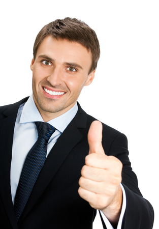 Happy smiling young businessman with thumbs up gesture, isolated over white background. Success in business, job and education concept shot. photo