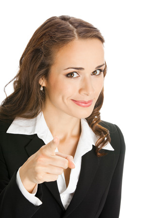 Portrait of young happy smiling businesswoman pointing finger at viewer, isolated over white background. Success, business and advertising concept. Stock Photo