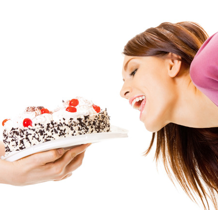 Cheerful woman eating pie, isolated over white background Stock Photo
