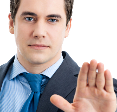 Serious business man showing stop gesture, isolated over white background Stock Photo