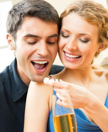 Cheerful couple eating cookies